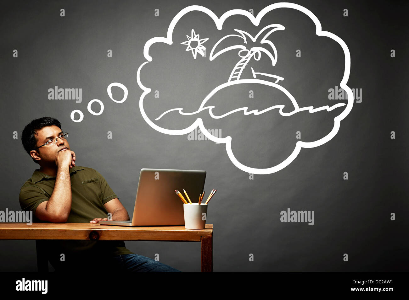 Man dreaming of island in the sun - Stock Image