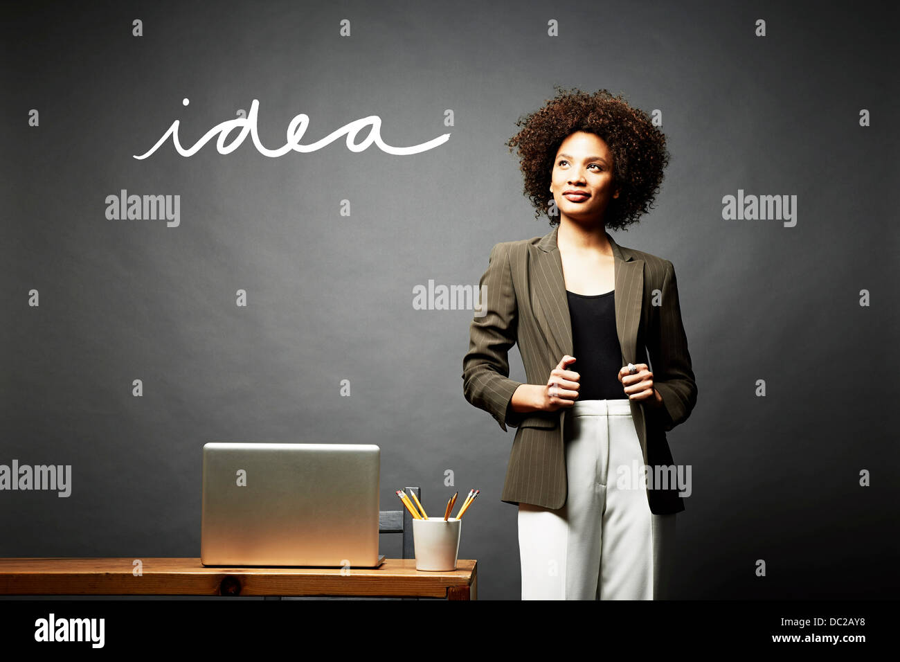 Woman and the word idea - Stock Image