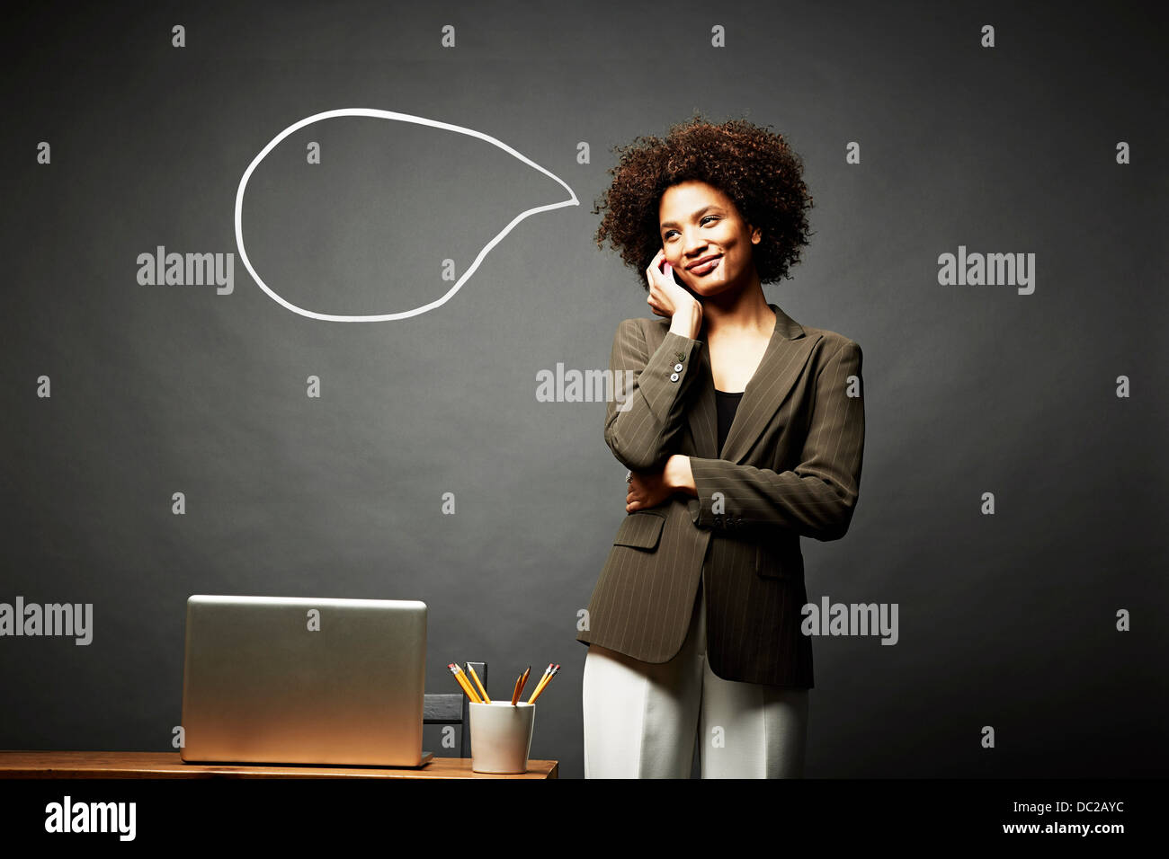 Woman smiling and speechless - Stock Image