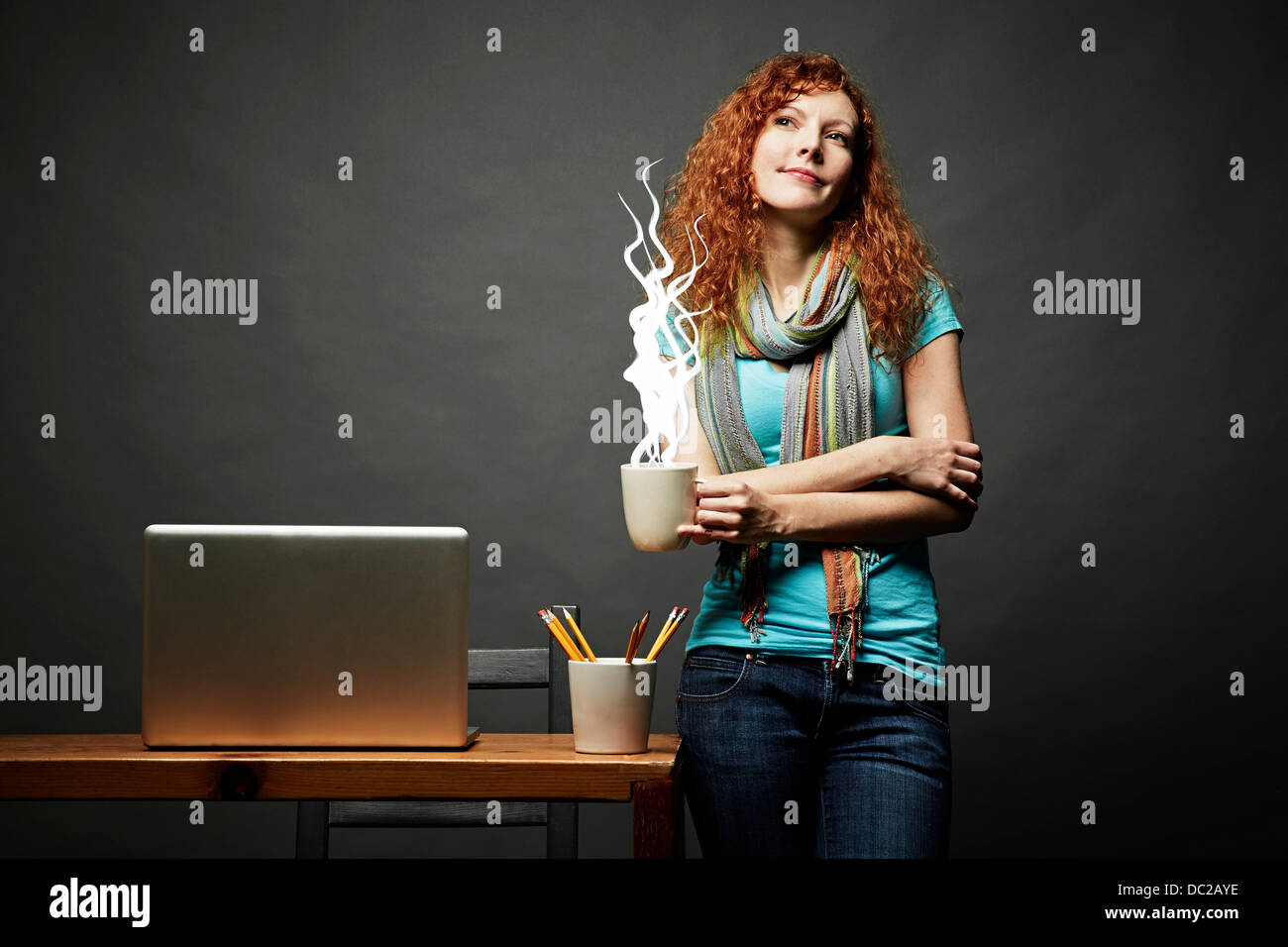 Woman enjoying cup of steaming hot beverage - Stock Image