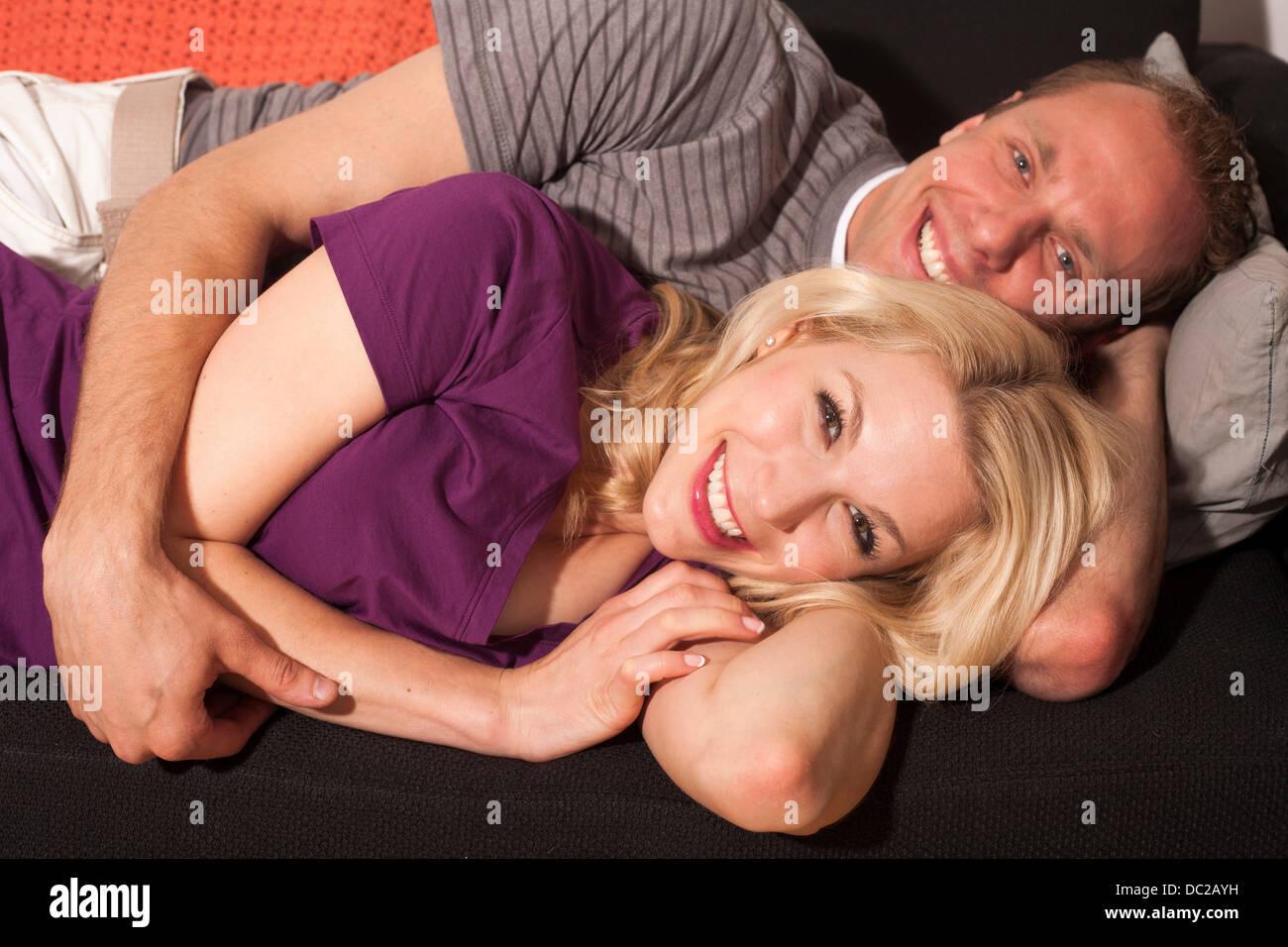 Couple cuddling - Stock Image
