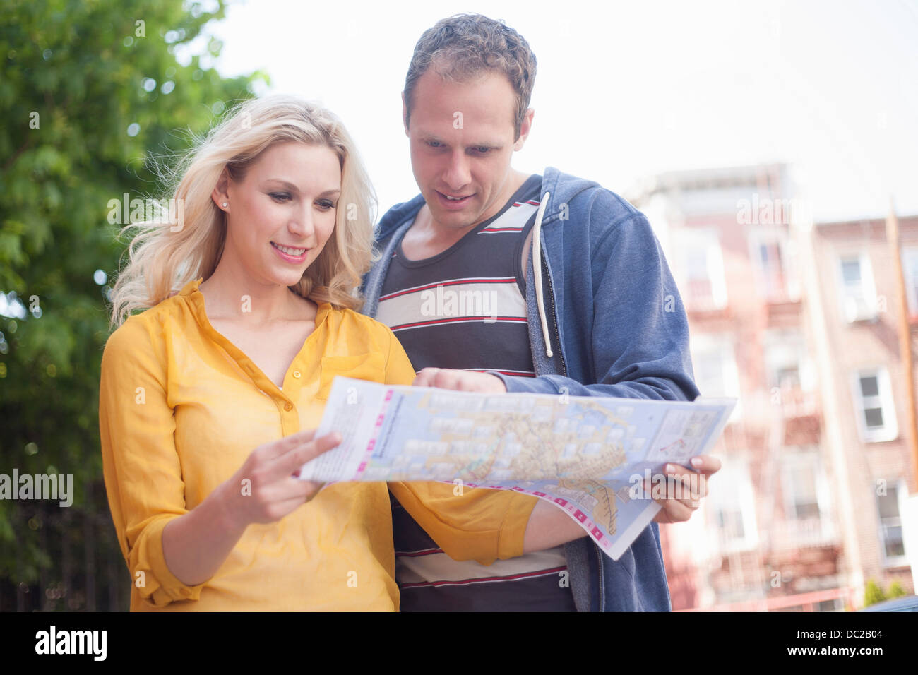 Couple reading map Stock Photo