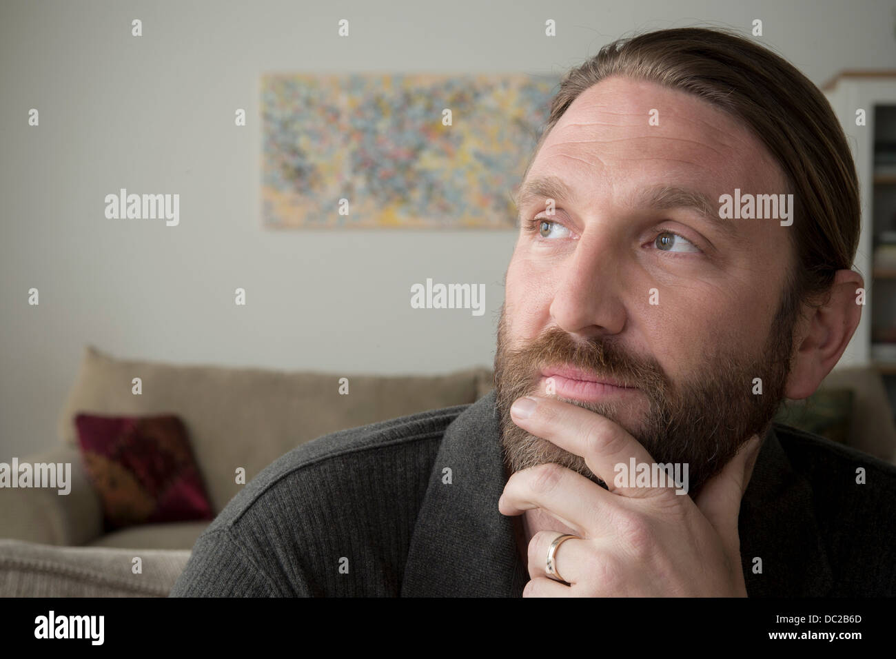 Man day dreaming - Stock Image