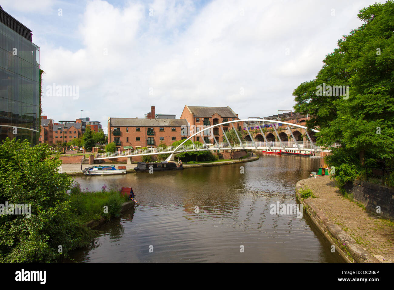 Bridgewater Canal in Castlefield, Manchester with Whitby and Bird Merchants Bridge - Stock Image