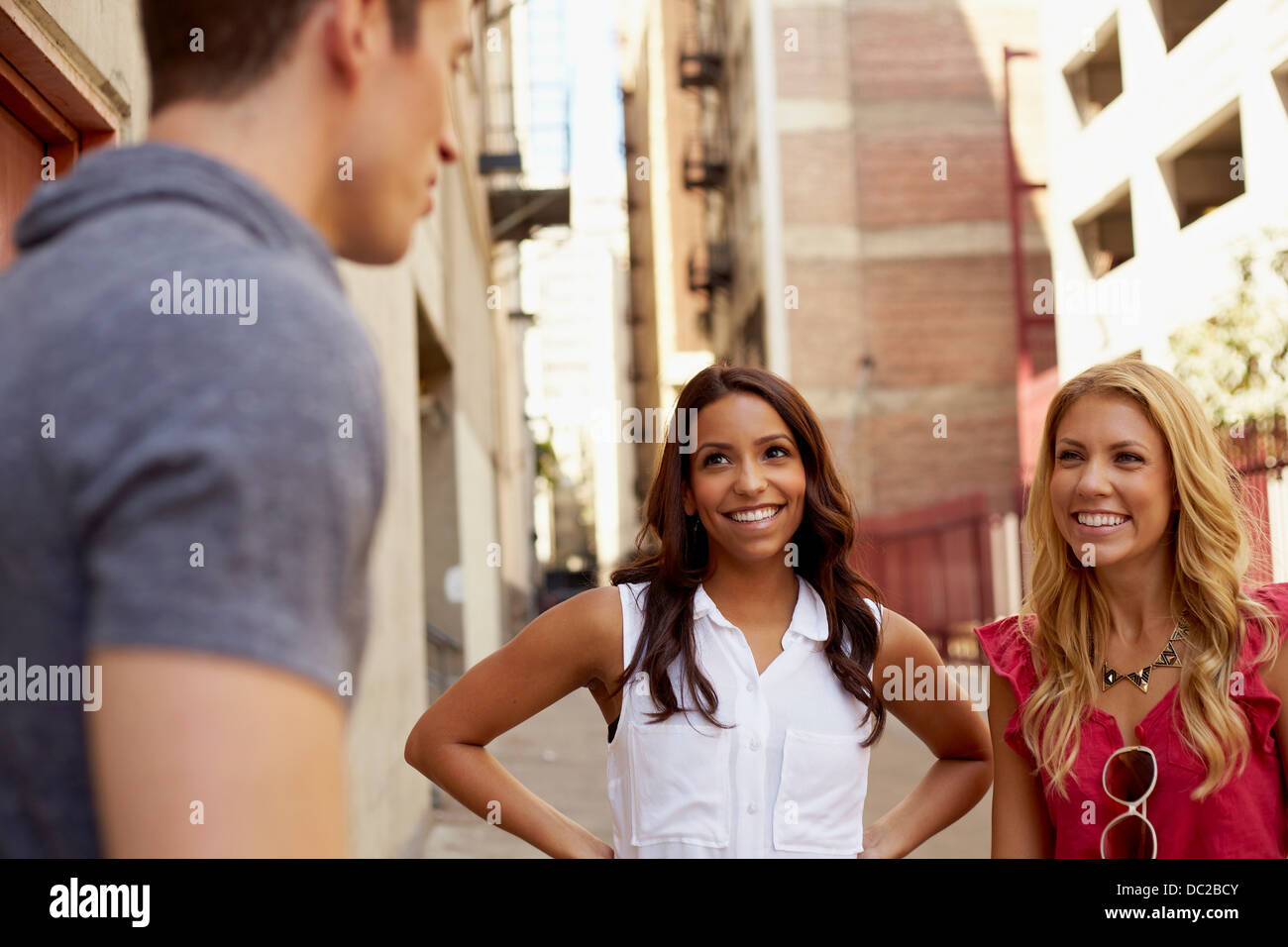 People chatting in back lane - Stock Image