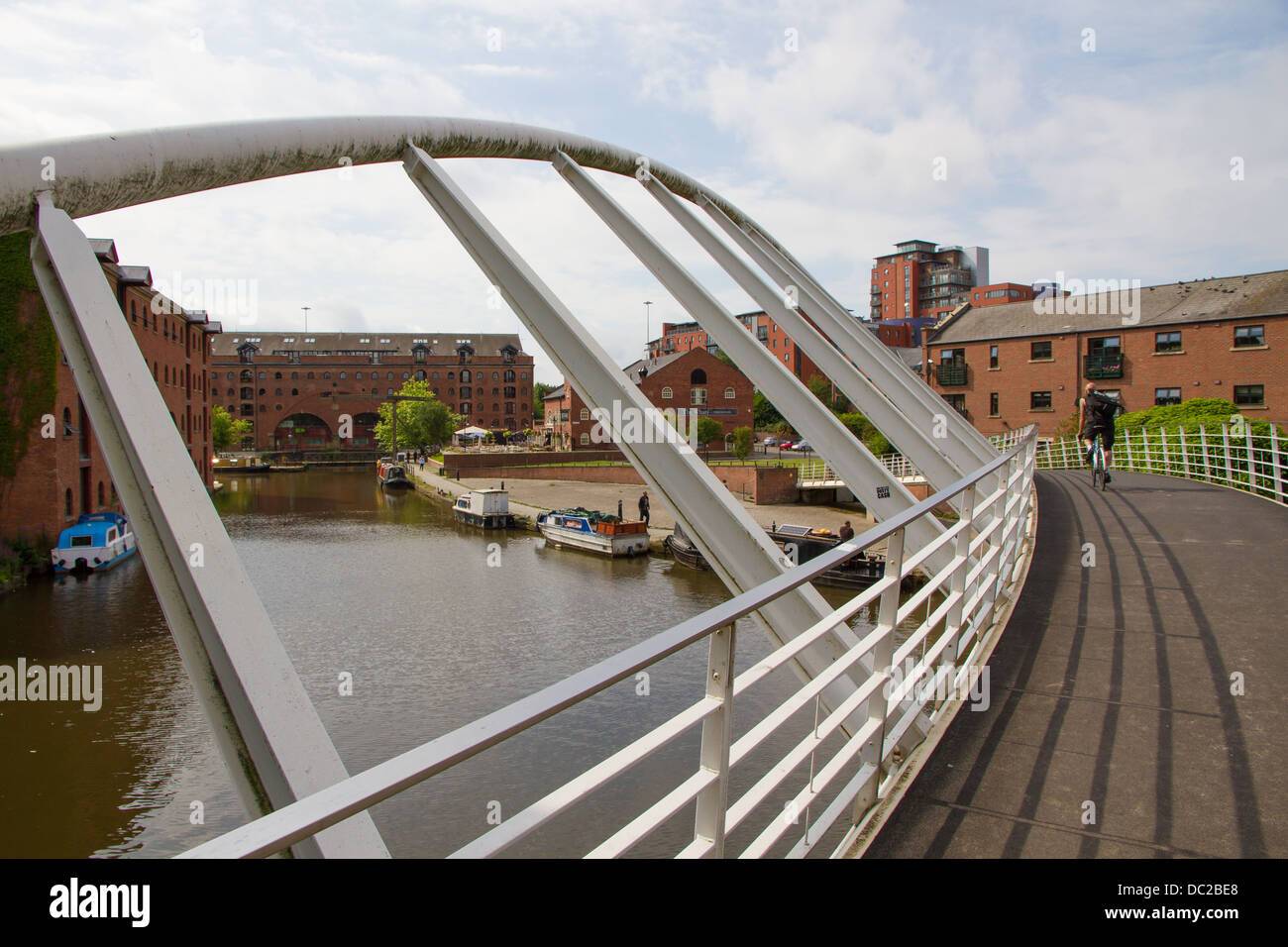 Looking from the Whitby and Bird Merchants Bridge across the Bridgewater Canal with Middle Warehouse - Stock Image