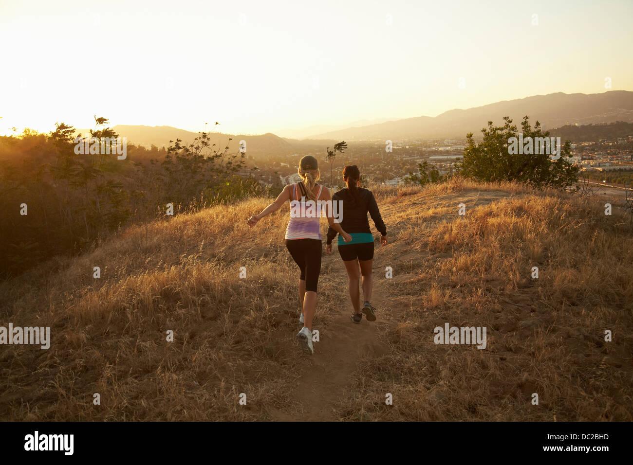 Women walking on dry landscape - Stock Image