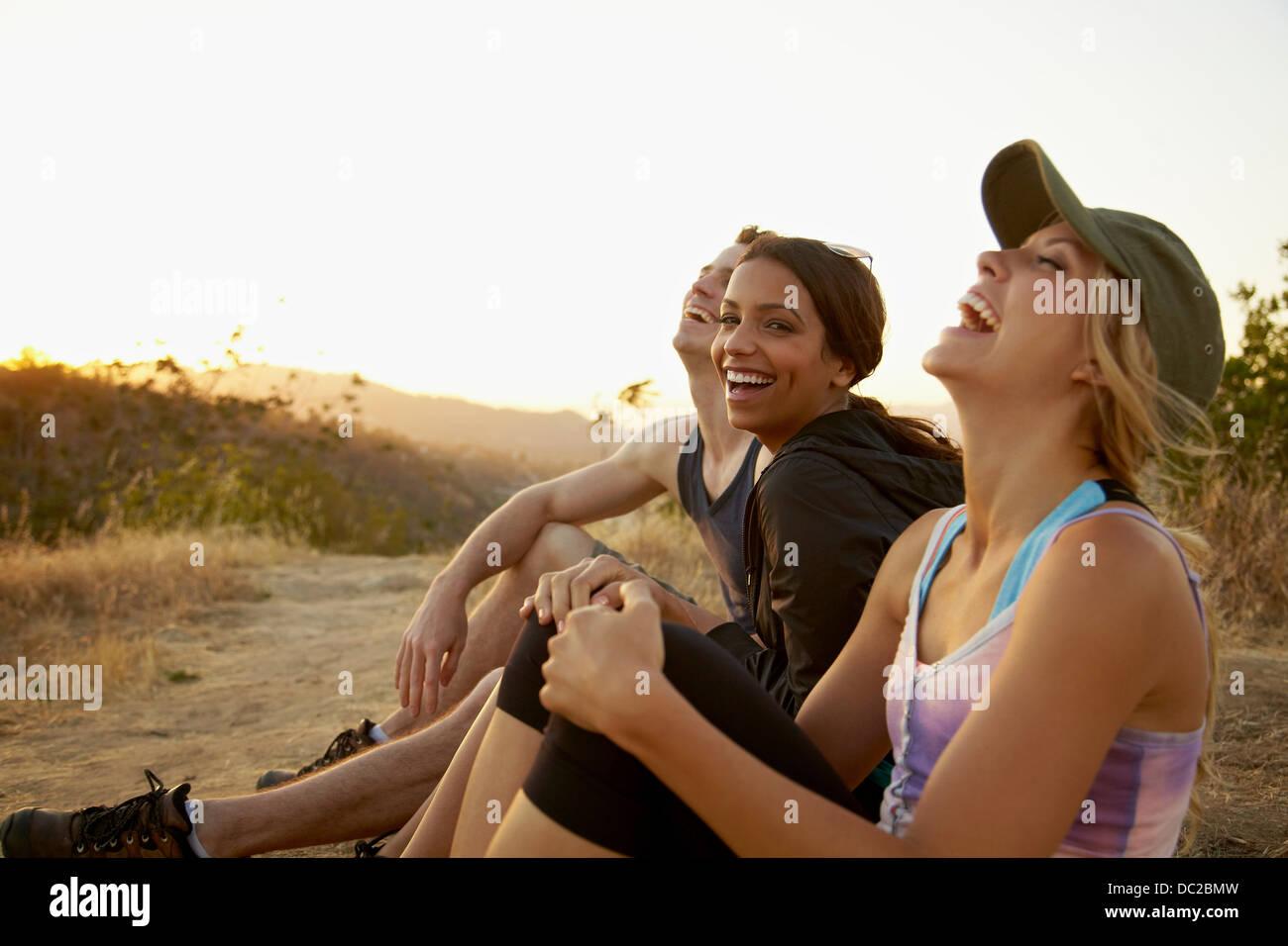 Friends enjoying hillside - Stock Image
