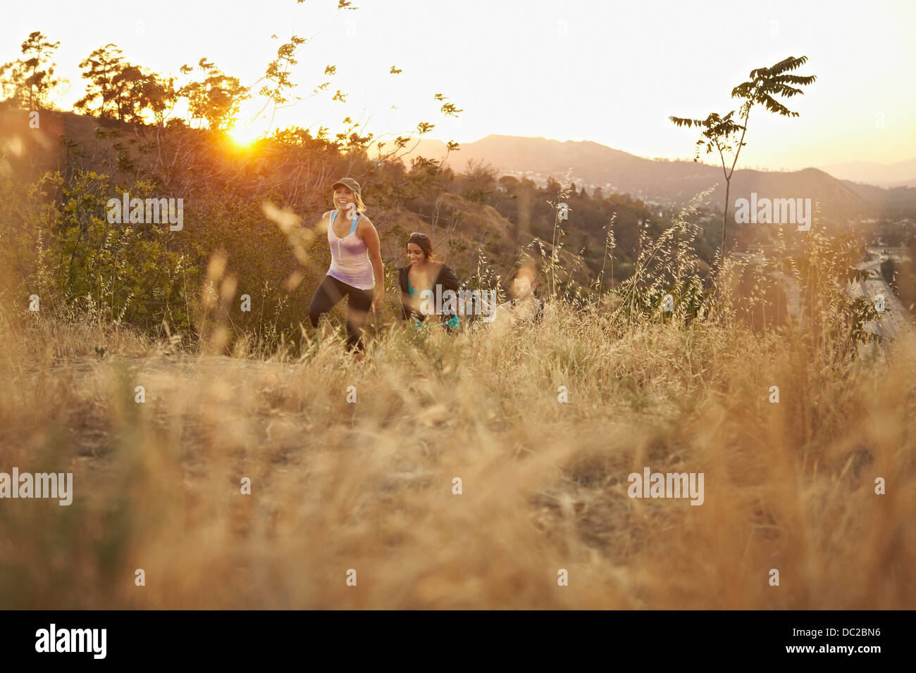 People walking up hillside path - Stock Image