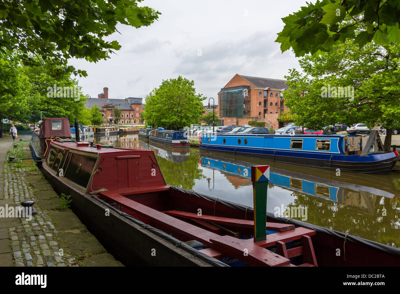 Canal boats moored up in the Castlefield are of Manchester, England. - Stock Image