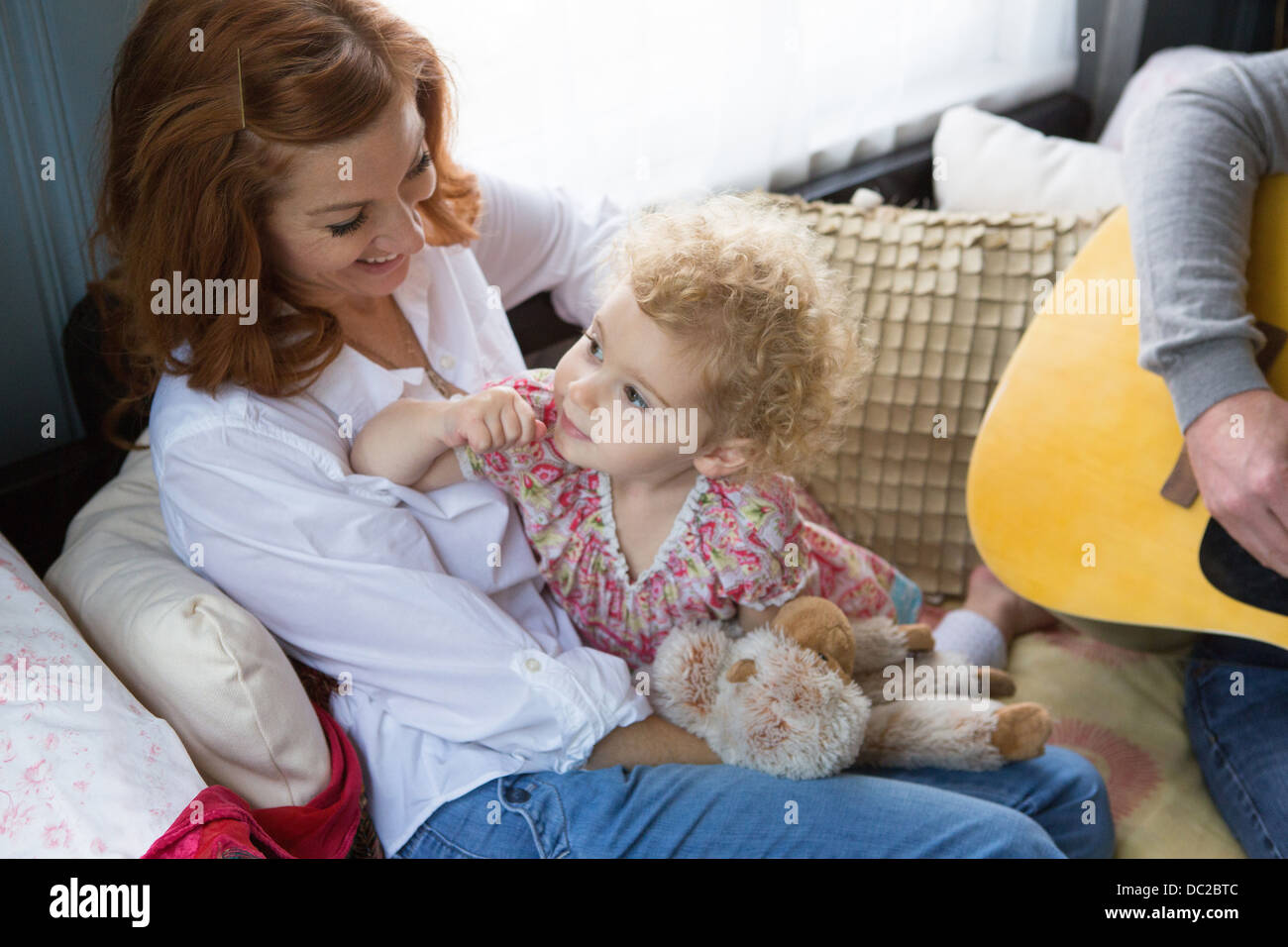 Mother smiling at child - Stock Image