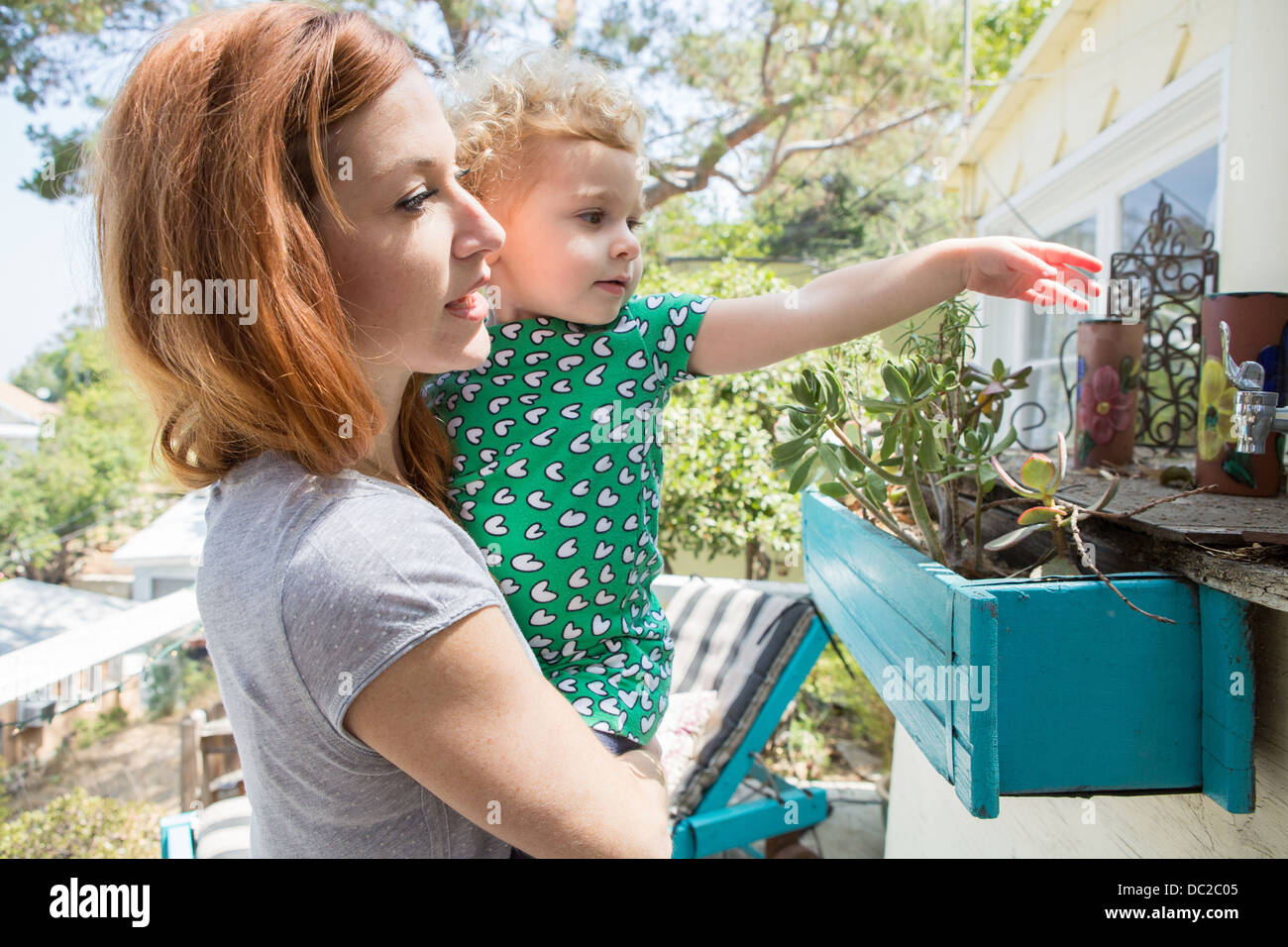 Mother and child exploring - Stock Image