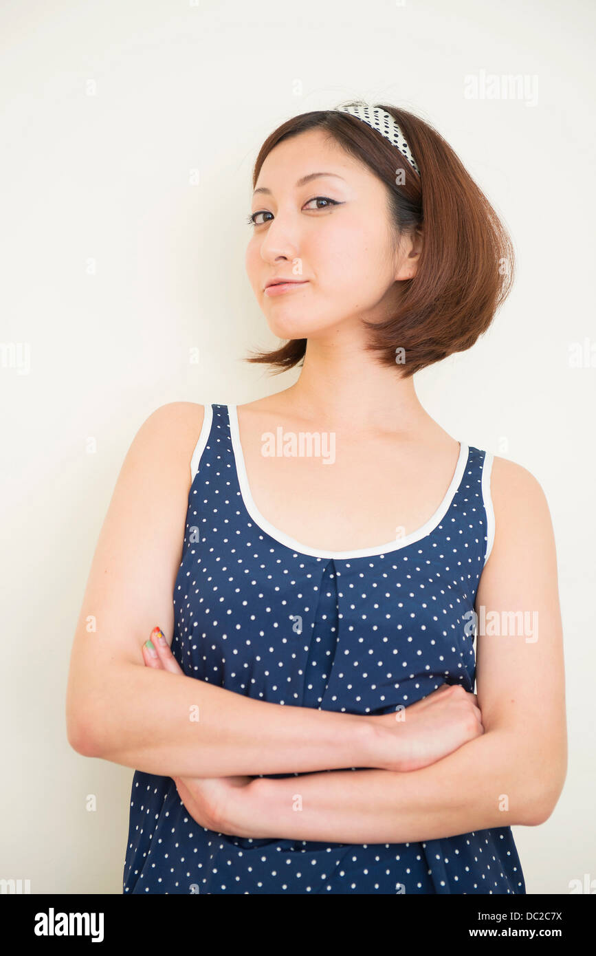 Woman wearing polka dots in haughty pose - Stock Image