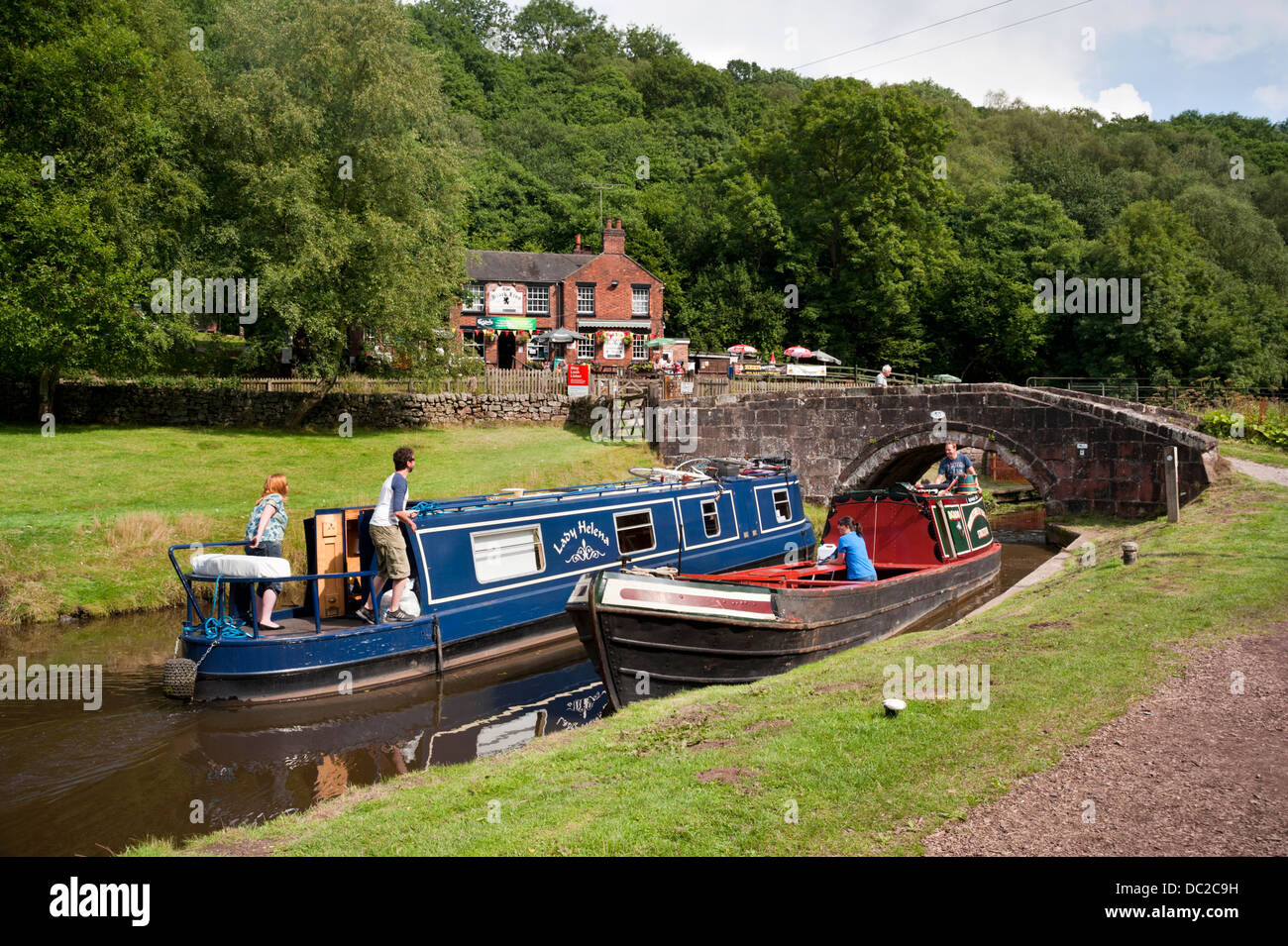 Narrowboats passing on a Summer's day on the Caldon Canal, Consall Forge,Churnet Valley, Staffordshire, UK. - Stock Image