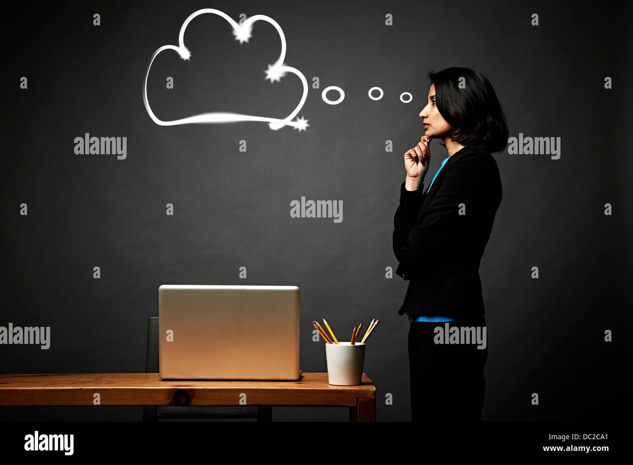 Woman contemplating problem - Stock Image