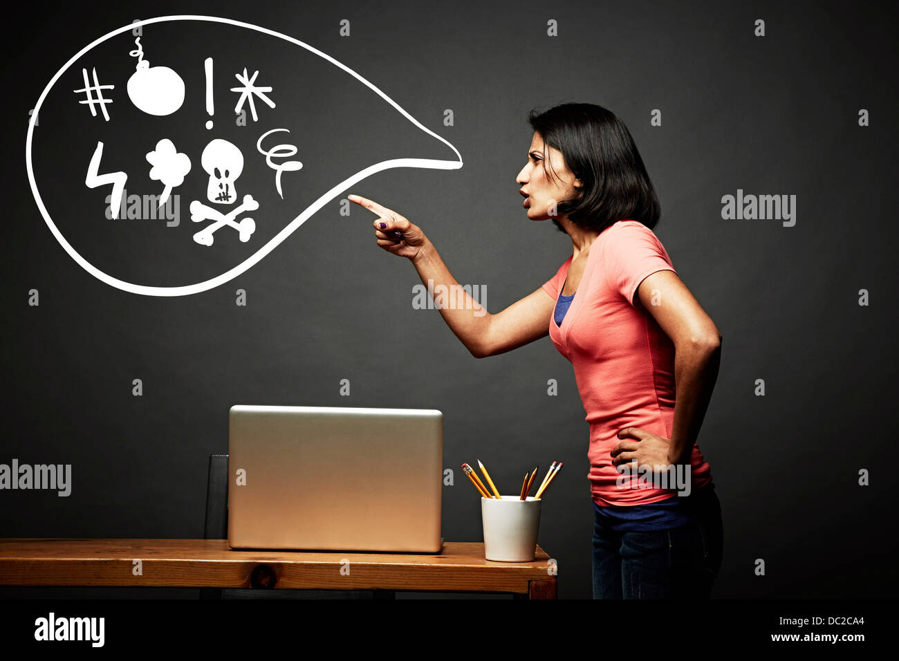 Woman pointing and shouting offensively - Stock Image