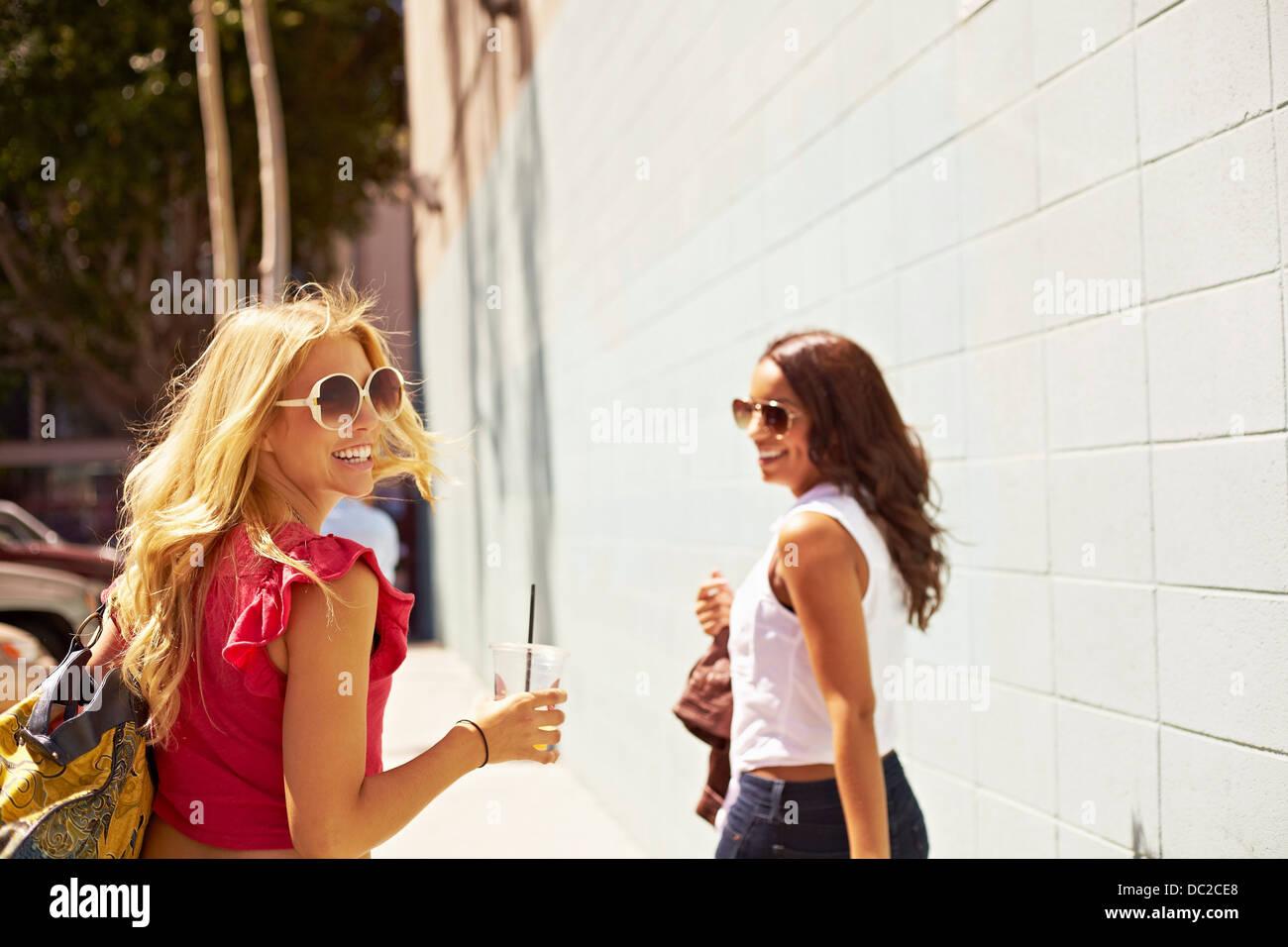 Women walking away - Stock Image