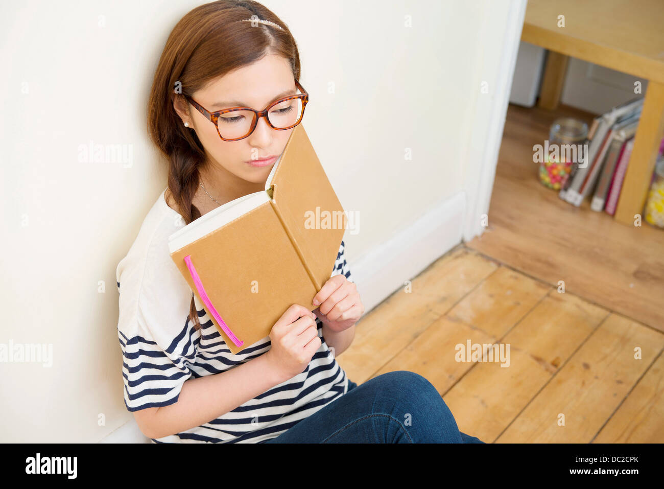 Woman day dreaming - Stock Image