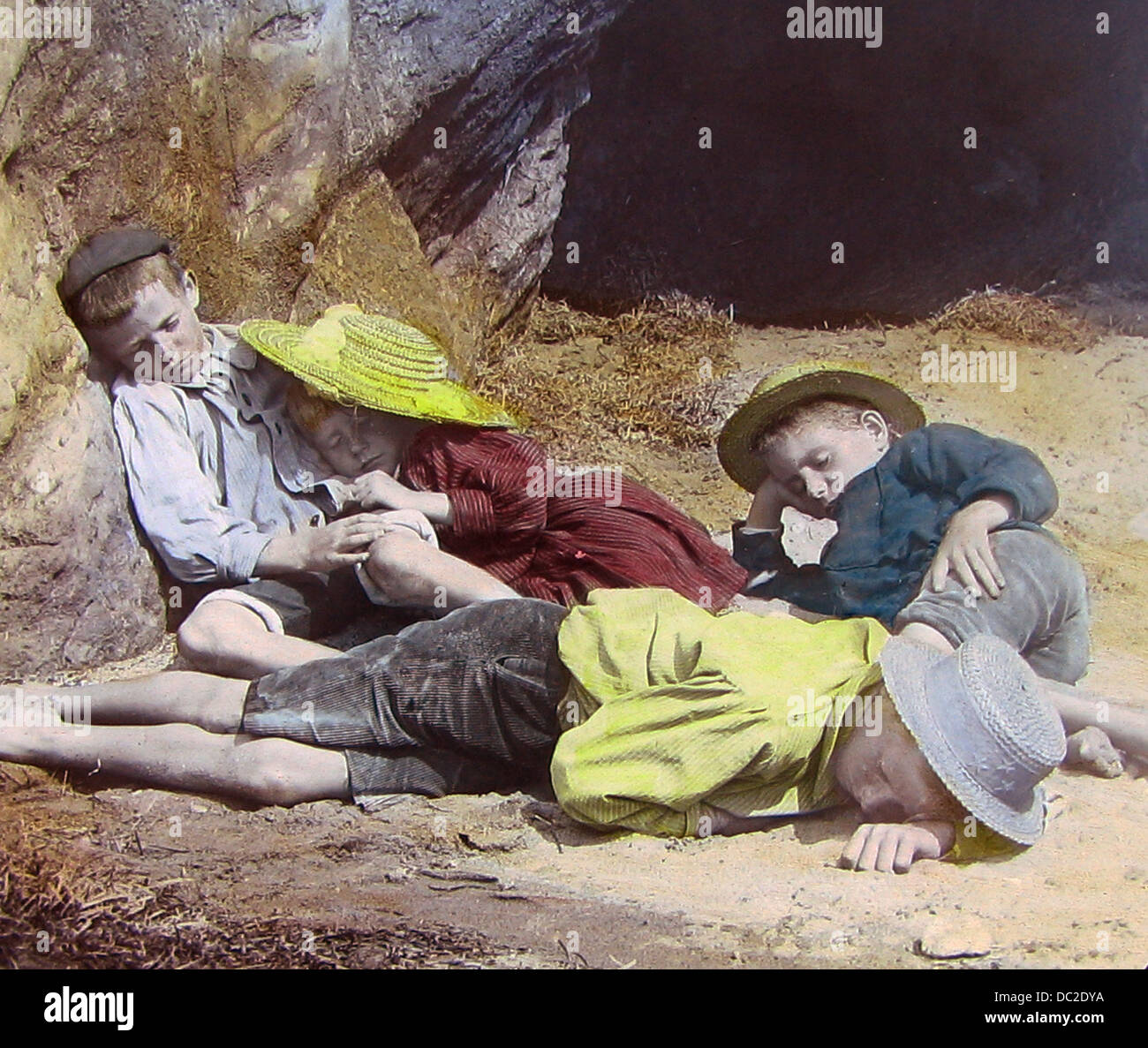 Children asleep on the beach Victorian period - Stock Image