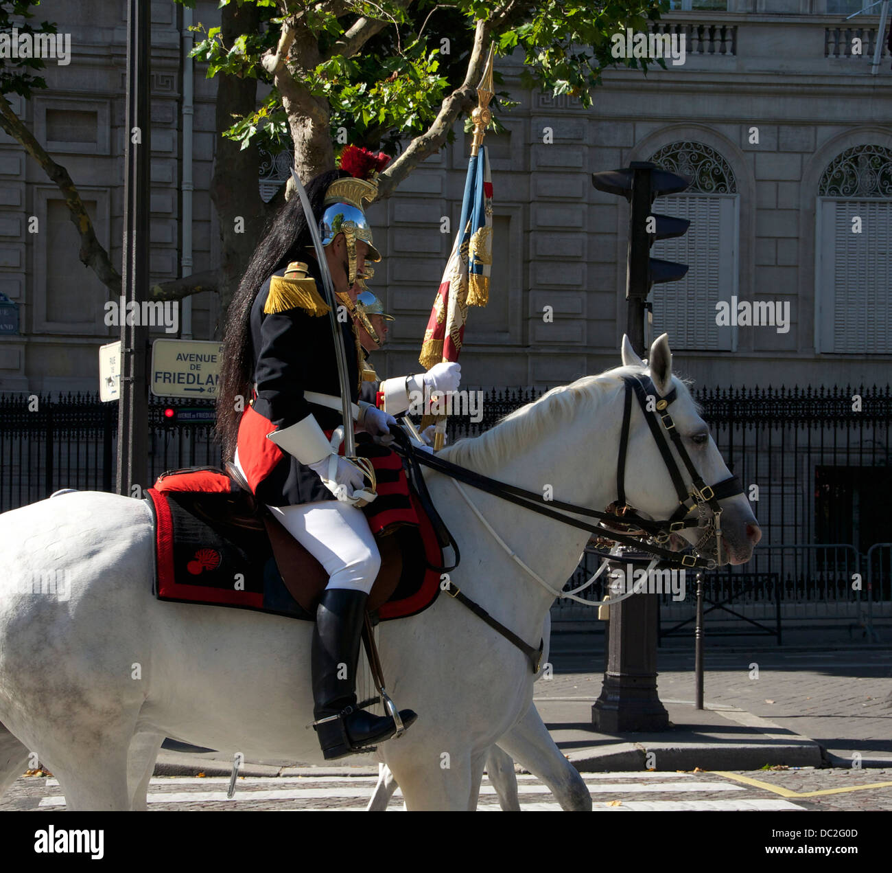The standard of the cavalry regiment of the Garde Républicaine and his guard. - Stock Image