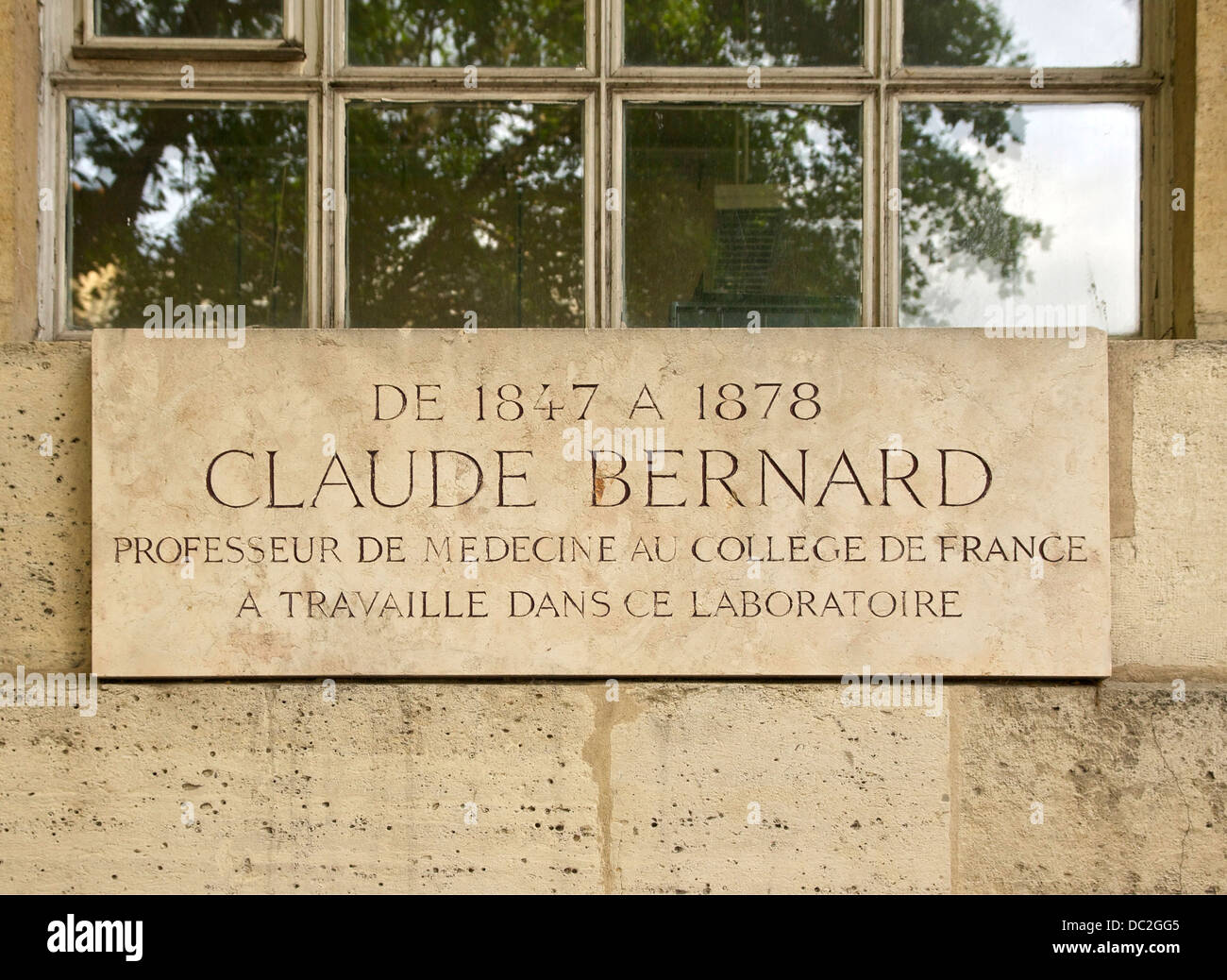 Plaque in tribute to Claude Bernard, at Collège de France in Paris, France. - Stock Image