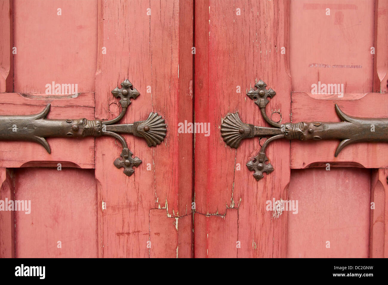 Closed doors of Hôtel de Cluny in Paris. Detail of the wrought iron hinges by Pierre Boulanger, (1813-1891), - Stock Image