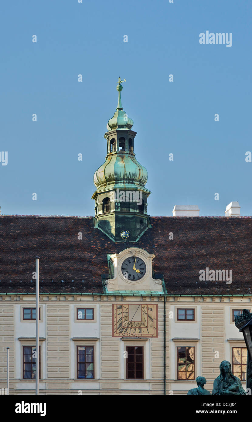 The baroque clocktower, the indication of the phases of the moon, the sundial, and a part of the facade of the 'Amalienburg' - Stock Image