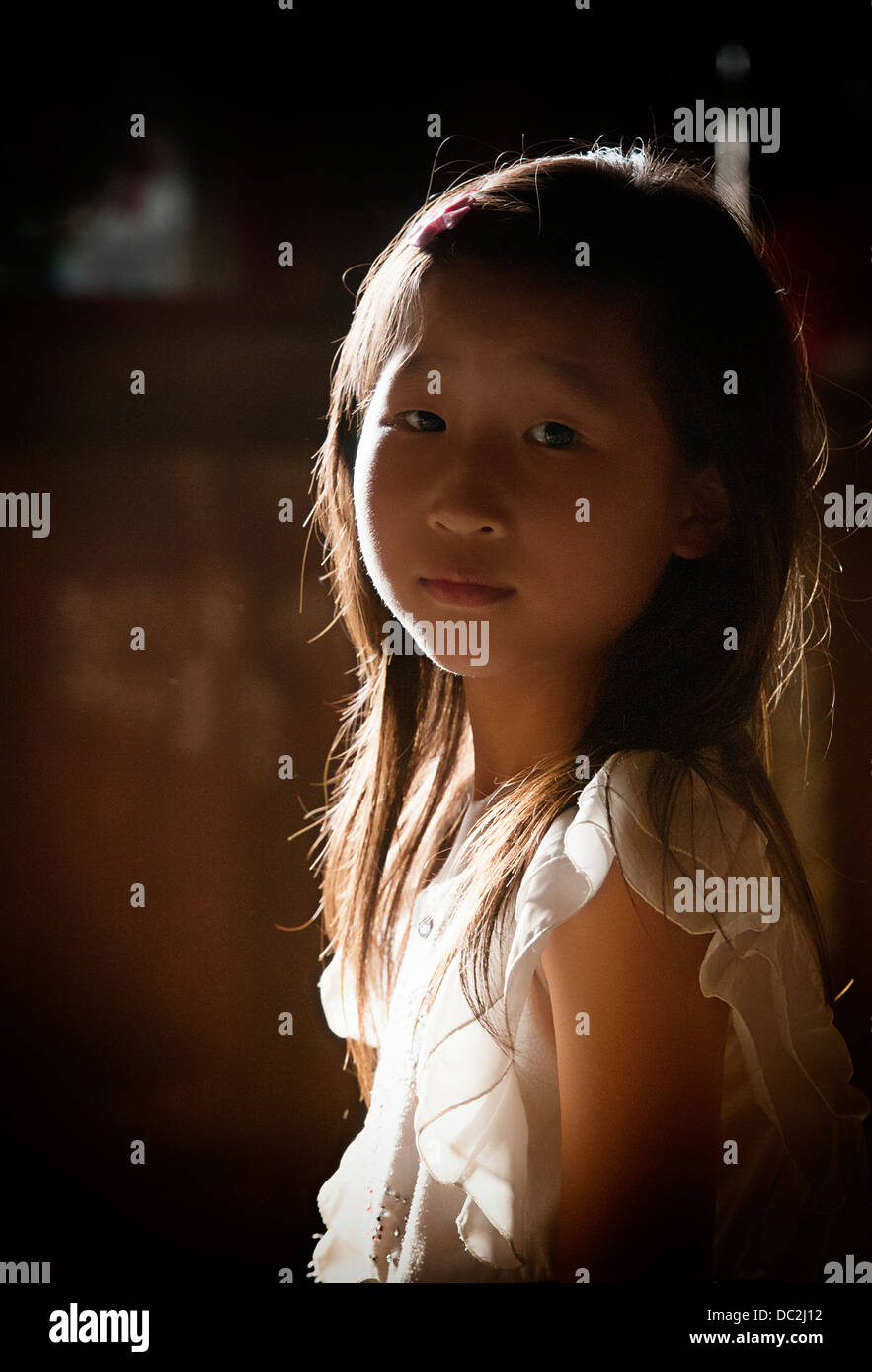 a Miao girl in backlighting - Stock Image