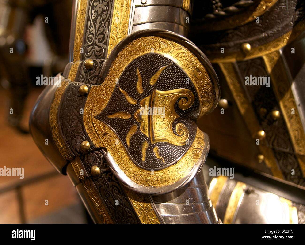 Couter of an Imperial armour, decorated with the Firesteel, one of the symbols of the House of Habsburg (see the - Stock Image