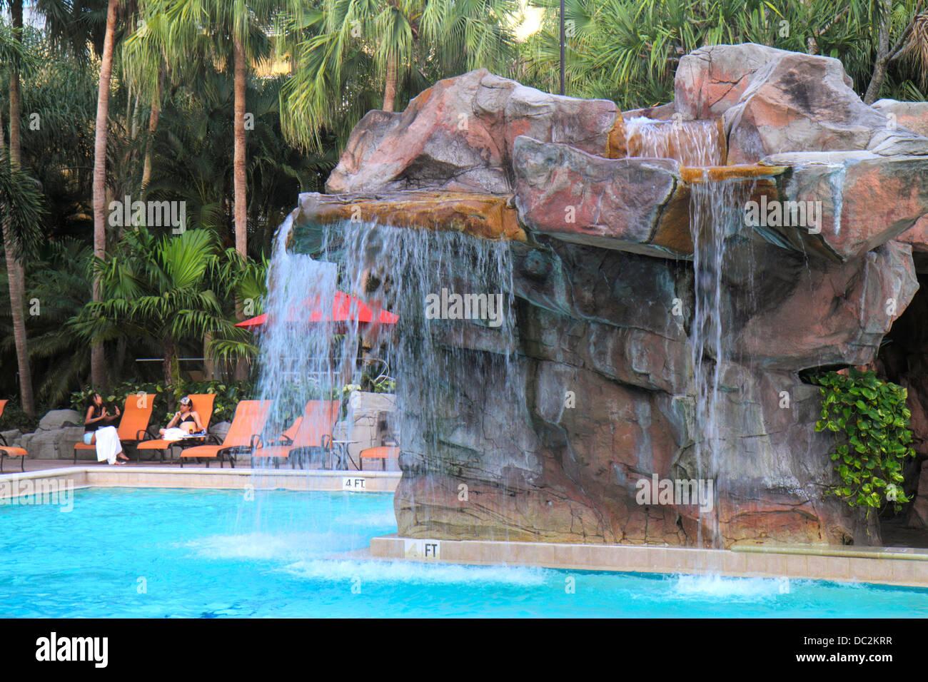 Florida Weston Fort Ft. Lauderdale Bonaventure Resort and & Spa hotel swimming pool area lounge chairs umbrella Stock Photo