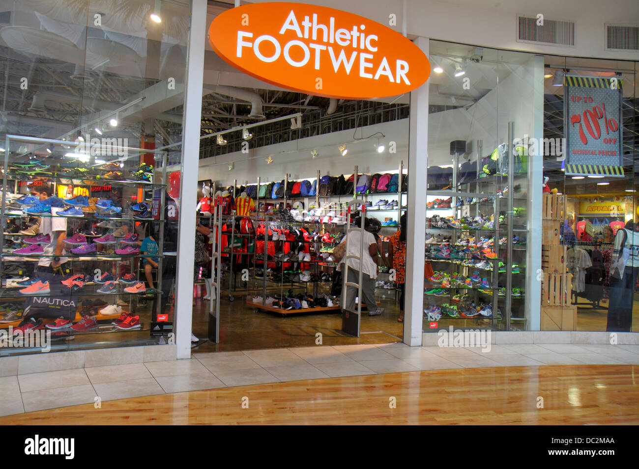 Florida Sunrise Fort Ft. Lauderdale Sawgrass Mills Mall shopping sale retail display front entrance Athletic Footwear - Stock Image