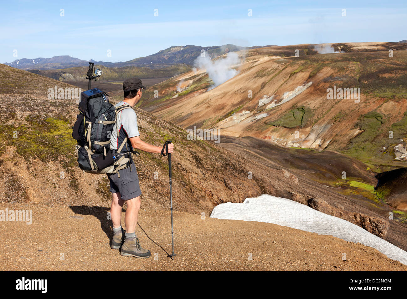 Hiker Looking Towards Volcanic Steam Vents on the Laugavegur Hiking Trail Fjallabak Iceland - Stock Image
