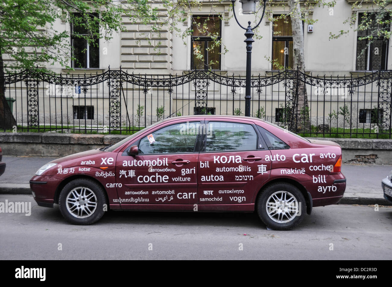 Multilingual Car. A car with 'CAR' written on it in many languages. Photographed in Budapest, Hungary - Stock Image