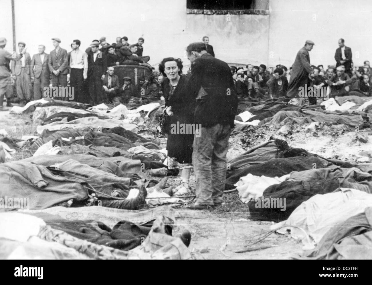 The Nazi Propaganda! on the back of the picture reads: 'In front of the victims of the Bolshevik terror. Ukrainians - Stock Image