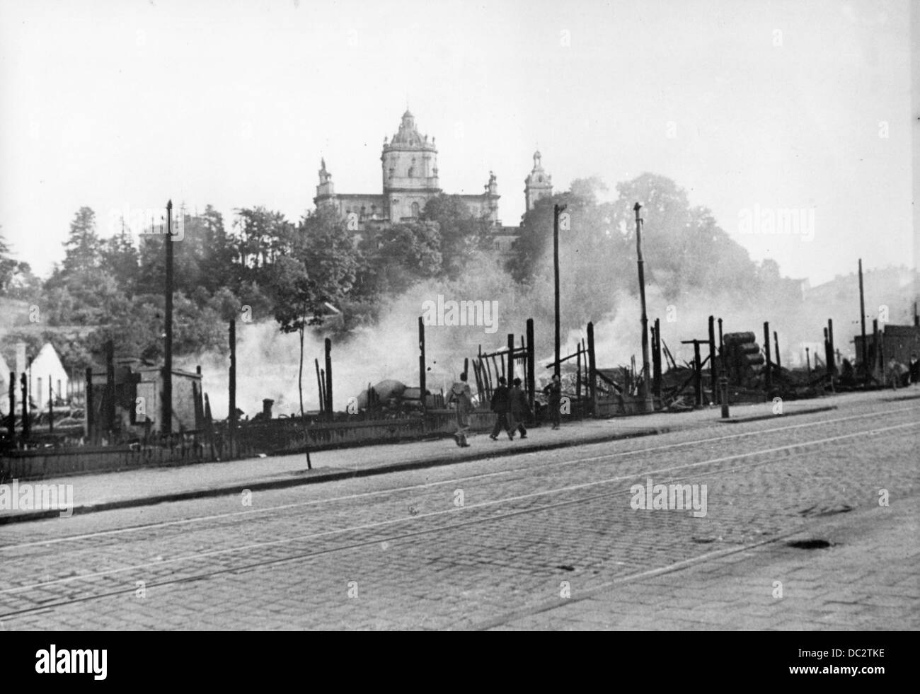 "The Nazi Propaganda! on the back of the picture reads: ""Advancement into Lviv. Burning barracks along the main street."" Stock Photo"