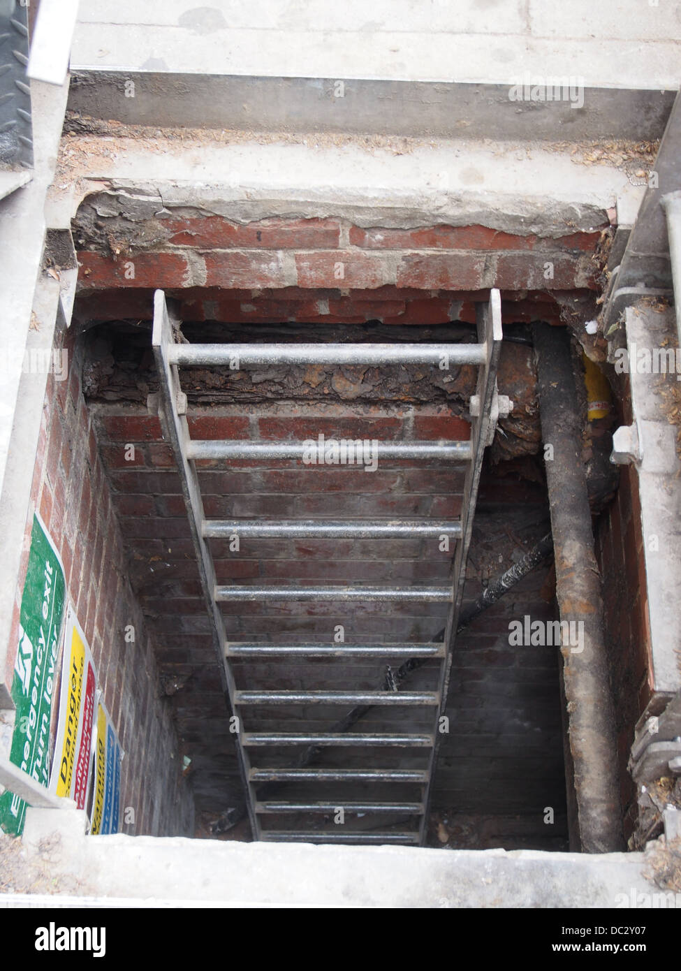 Ladder leading to a sewer - Stock Image