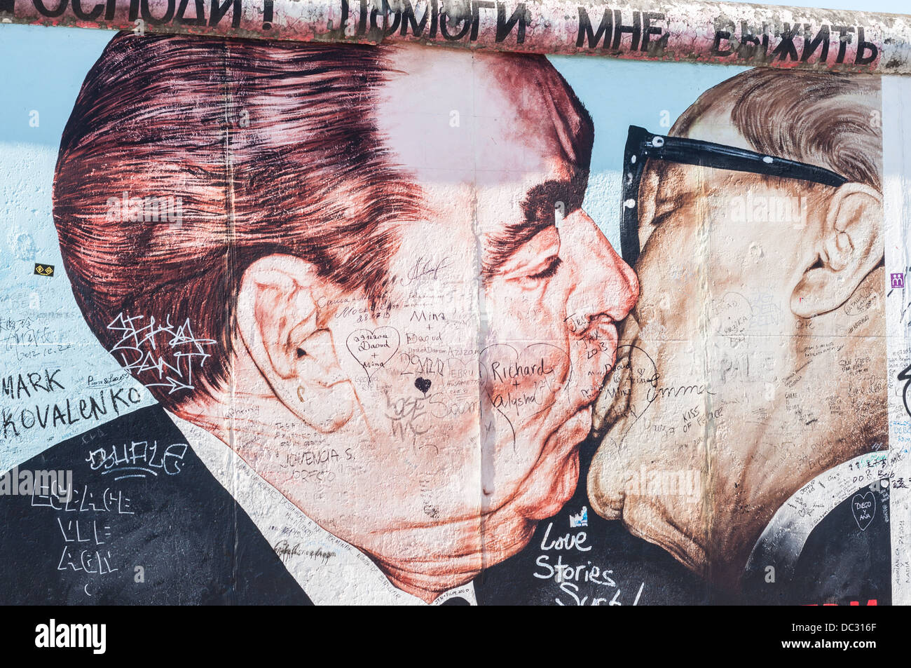 East Side Gallery, part of the Berlin Wall with graffiti, street art, brotherly kiss Breschnew and Honecker - Germany - Stock Image