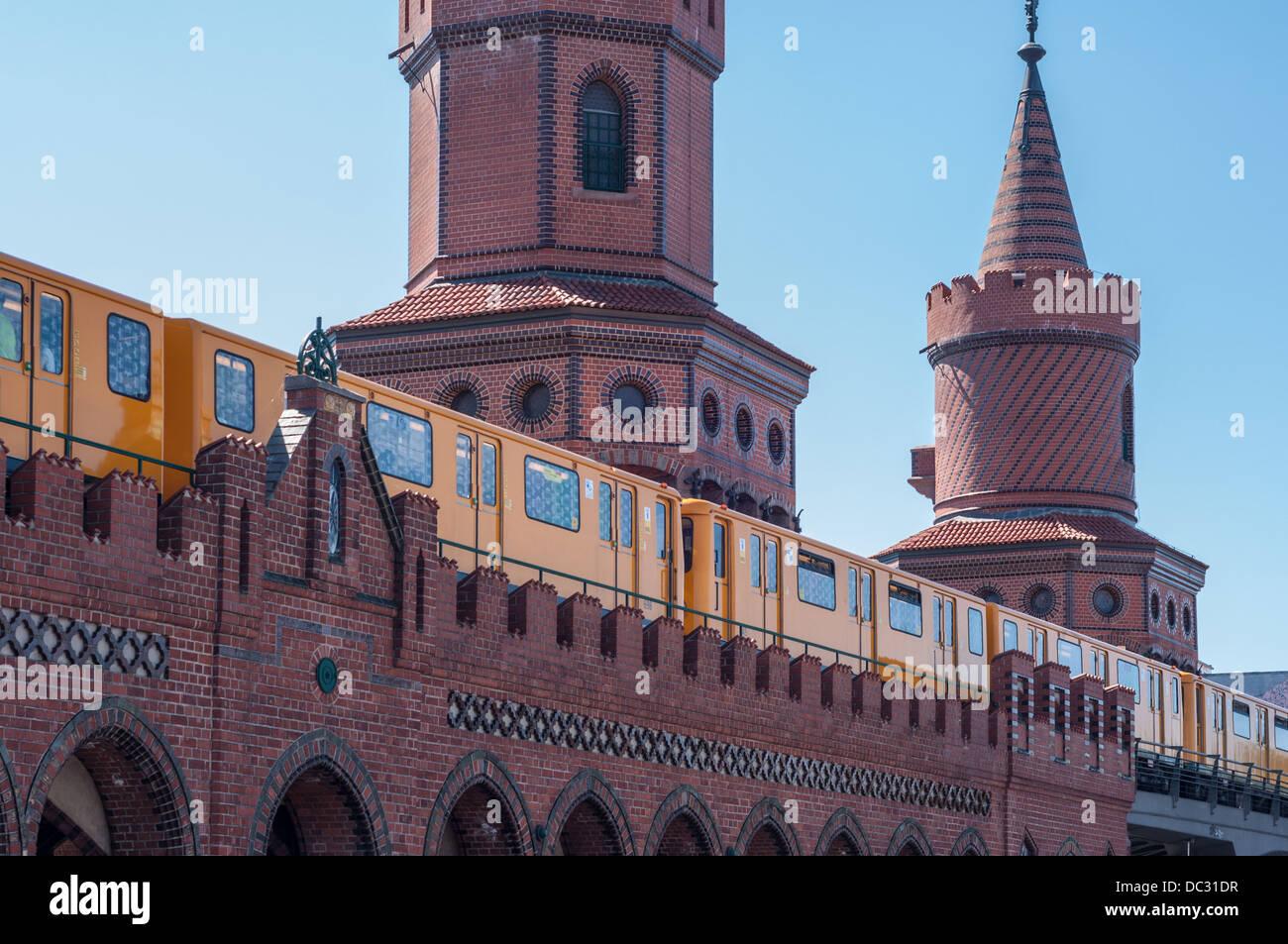 U-Bahn (subway) train traversing the Oberbaum Bruecke, Oberbaum Bridge, Berlin Germany. Stock Photo