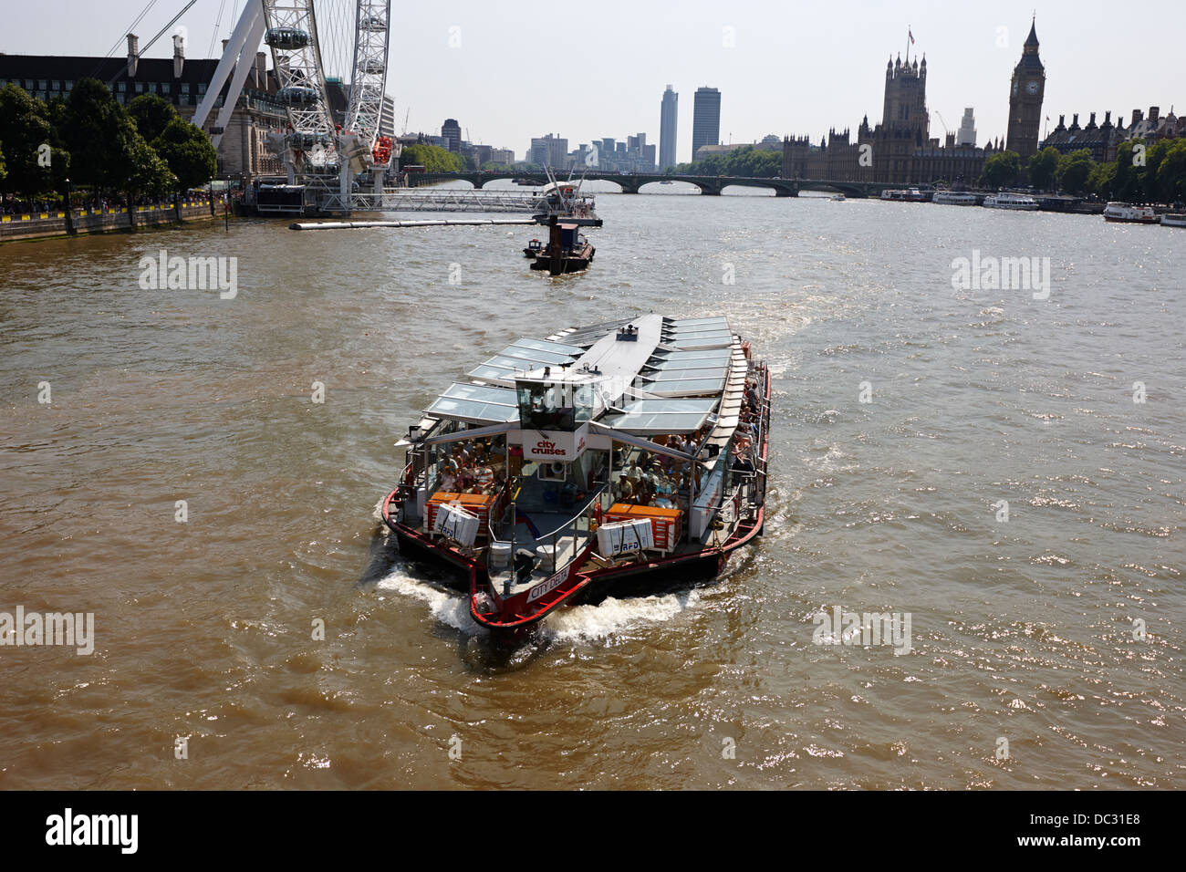 city cruises city delta boat on the river thames London England UK - Stock Image