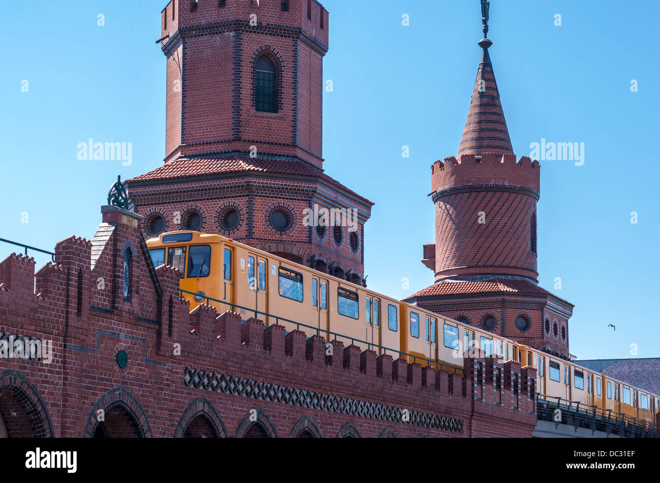 U-Bahn (subway) train traversing the Oberbaum Bruecke, Oberbaum Bridge, Berlin Germany. Stock Photo