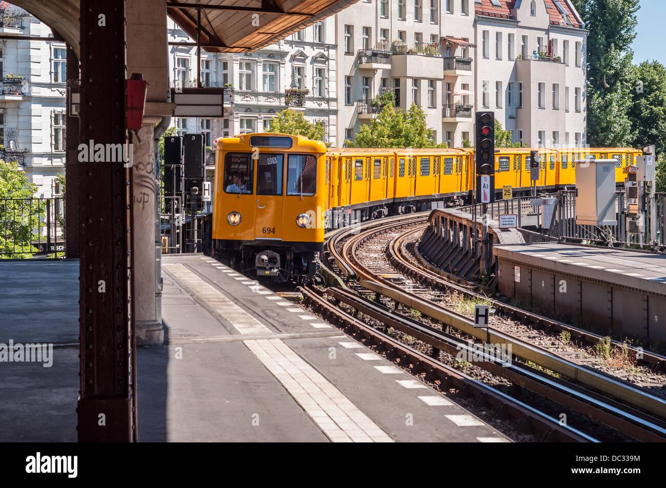 Berlin Germany - Commuter train approaching railway station Stock Photo