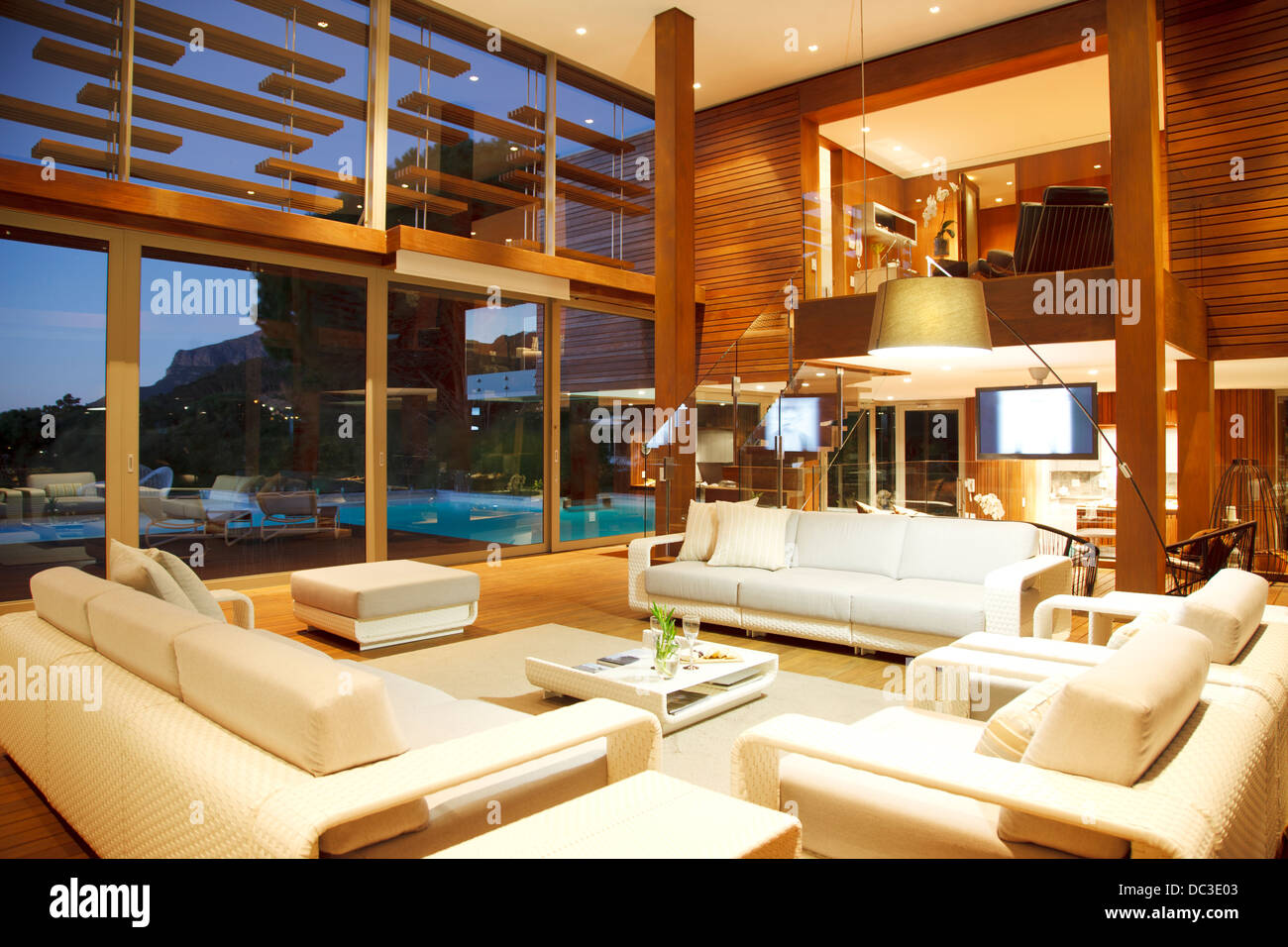 Illuminated Modern Living Room At Night Stock Photo Alamy