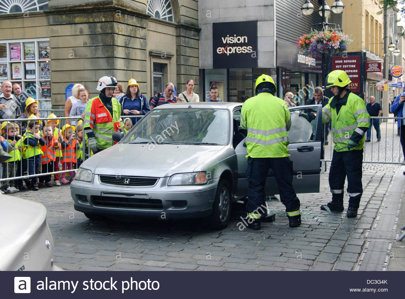 Falkirk UK on Thursday August 8 2013. Removing the doors from a vehicle in preparation for extricating the casualty. The Scottish Fire and Rescue Service ... & Falkirk UK on Thursday August 8 2013. Removing the doors from a ...