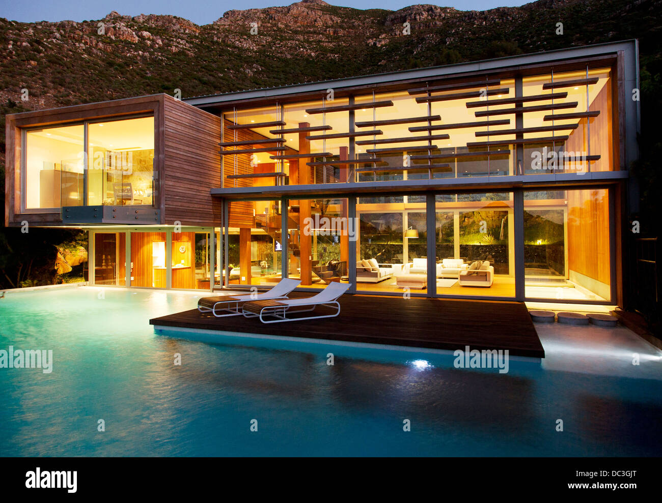 home swimming pools at night. Swimming Pool And Modern House At Night Home Pools Alamy