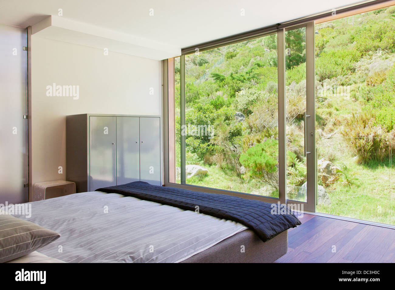 Modern Bedroom With Glass Sliding Doors Stock Photo 59086172 Alamy