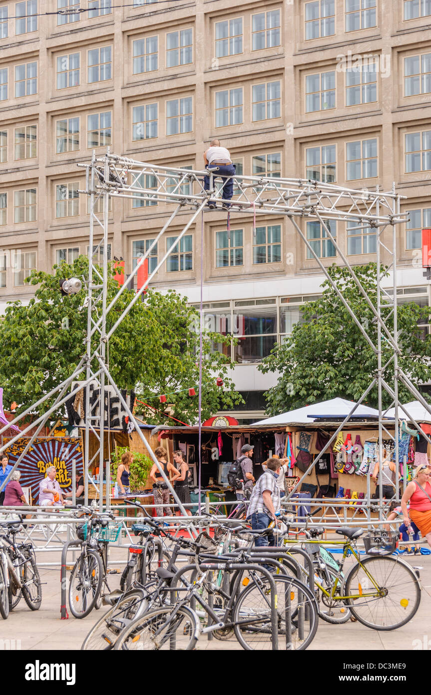 Stage rigger, technician, rigging up a truss for a public event - Berlin Alexanderplatz (Alex) Stock Photo