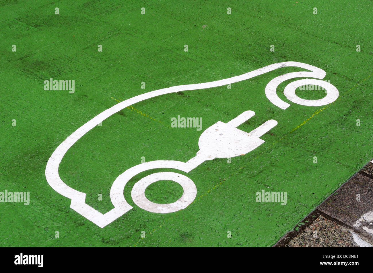 Informative symbol for green energy painted on road for electric car owners - Stock Image