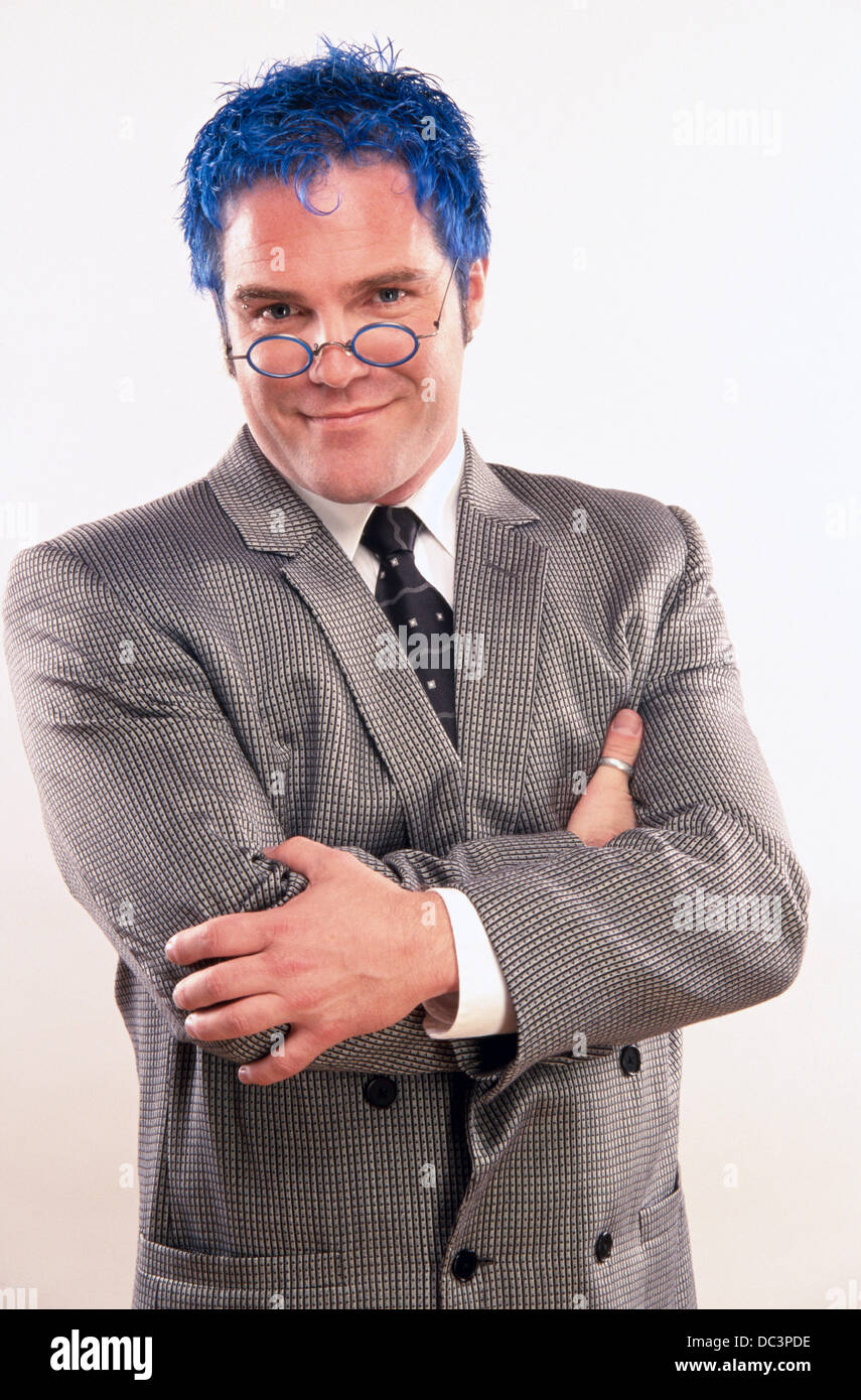 Business man with blue hair - Stock Image