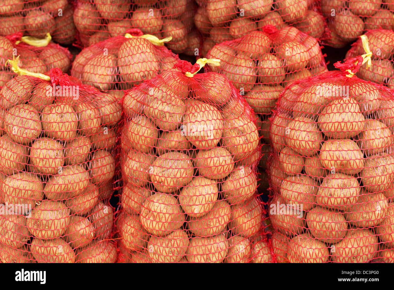 Red potato sacks on the street market - Stock Image