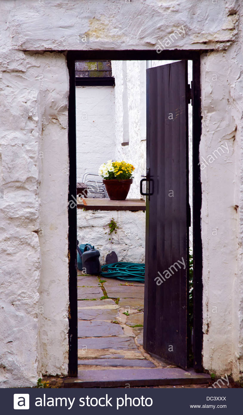 Wooden Back Door Stock Photos Images Alamy Framed Doors Over Fuse Box Open Leading Into A Backyard With Hoepipe Watering Can And Pot Of